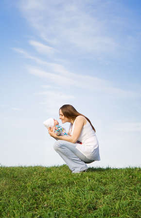 Mother and little baby. Sky. Grass. 2 Stock Photo - 579095