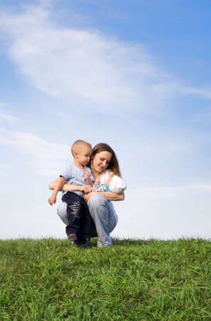 Mother with childrens. Sky. Grass. 2 Stock Photo - 579094
