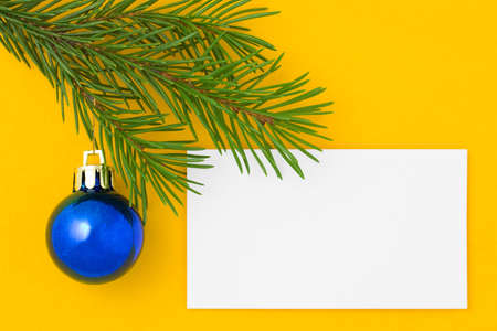 Christmas postcard with blue ball. Yellow background. 3 photo