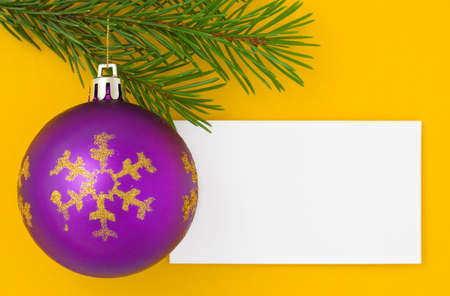 Christmas postcard for your congratulations. Yellow background photo