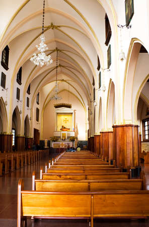 Old catholic church at Bogota, Colombia. Benches, arches. photo