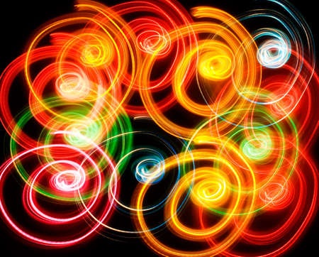 Spiral shapes lights. Colorful. Isolated. Black background photo