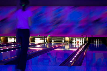 eventide: Strike in bowling. Nice shoot. Ultraviolet illumination Stock Photo