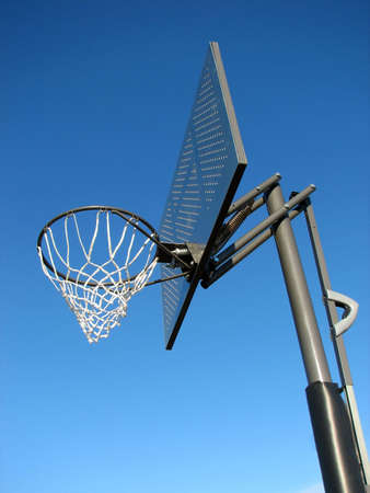 New basketball backboard and clear sky photo