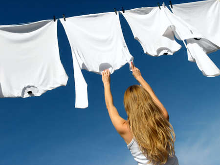 hanging woman: Longhaired girl, blue sky and white laundry