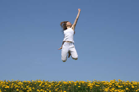 Success! Smiling young woman in a happy jump. Stock Photo - 1017554