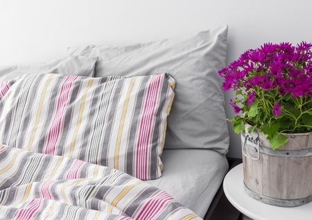 bedlinen: Modern bedroom decorated with bright purple flowers  Fresh design
