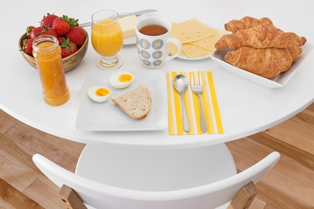 round chairs: Breakfast is ready  White round table with healthy morning meal