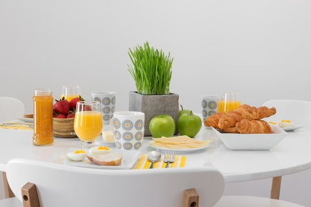 Fresh tasty breakfast served on a white table  photo