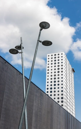 Modern urban architecture  Building with round windows and streetlights