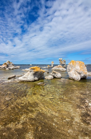 Sea stacks  raukar  on F�r� island in Gotland, Sweden  These limestone formations are caused by natural erosion  photo