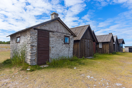 scandinavian landscape: Old fishing village with wooden and stone houses on  island, Sweden