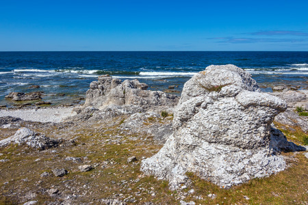 Rocky coast of F�r� island in Gotland, Sweden  Rock formation reminding a head of a bird  photo