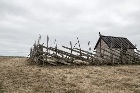 Old farmhouse in the field  Island of Gotland, Sweden  photo