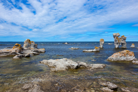 Rocky coastline, Fårö island in Gotland, Sweden  These cliffs are locally known as   raukar   photo