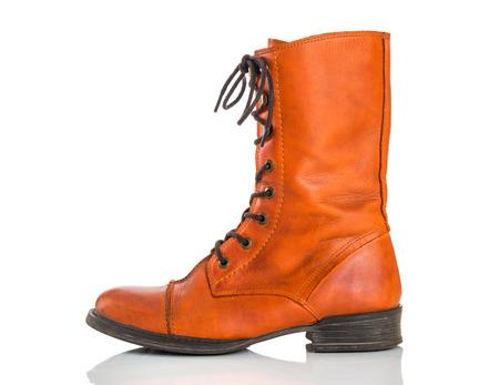 shoestrings: Stylish orange leather boot, isolated on white .