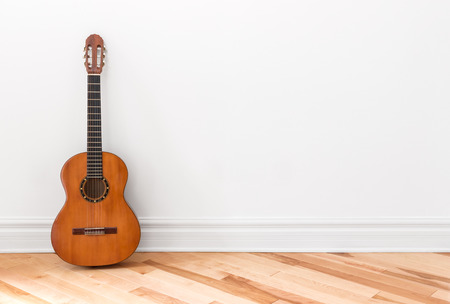 room for text: Classical guitar in an empty room, with copy space