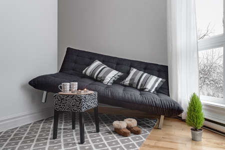 lack: Lack of space. Sofa that didnt fit into the living room. Stock Photo
