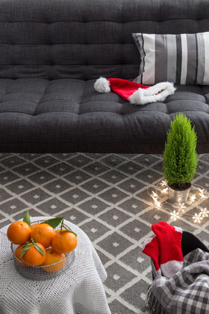 Cozy interior with Christmas decorations and little green tree. photo