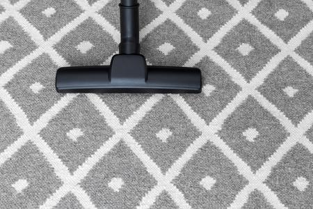 carpet clean: Housework. Vacuum cleaner on gray carpet.