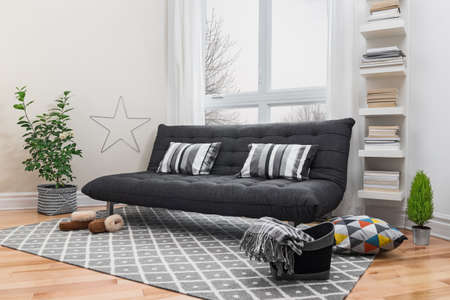living room sofa: Spacious living room with gray sofa and modern decor
