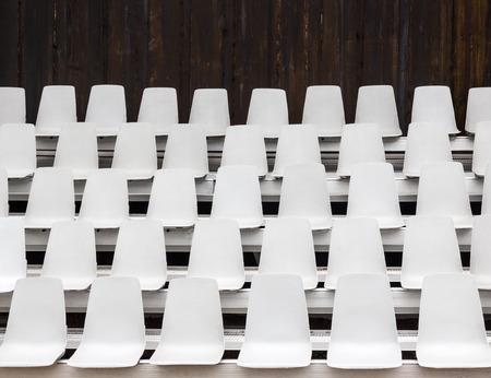 venue: White empty seats in an outdoor venue