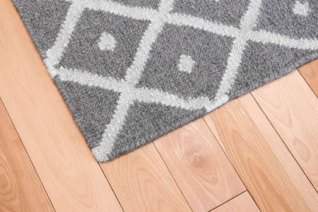 Contemporary gray wool rug on wooden floor