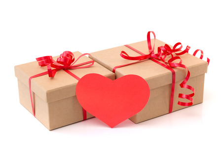 Valentine gift boxes with red heart, isolated on white  photo