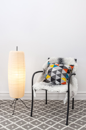 floor lamp: Home decorating  Chair with bright cushion and elegant floor lamp