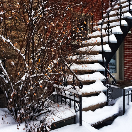 Staircase covered by snow during a sudden snowstorm in Montreal, Canada  photo