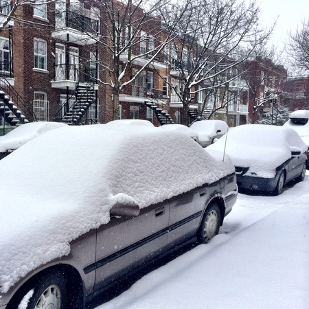 Cars covered by snow after the snowstorm  Winter in Montreal, Canada  photo