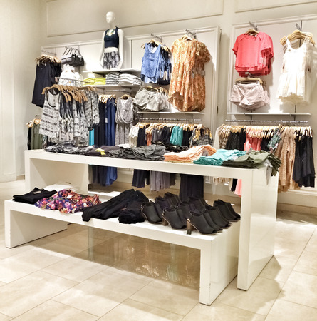 Interior of a clothing store with clothes for women  photo