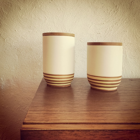 drawers: Ceramic vases decorating a wooden chest of drawers