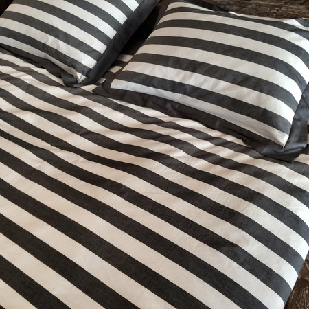 bedlinen: Bed with stylish black and white bed linen