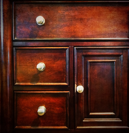 drawers: Dark wooden chest of drawers  Vintage dresser  Stock Photo