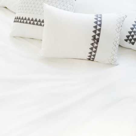 white sheet: Bed with elegant white bed linen and pillows