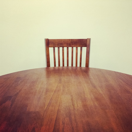 dining table and chairs: Classic style round wooden table and chair  Stock Photo