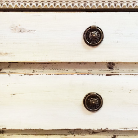 drawers: Old style white chest of drawers with metal handles  Stock Photo