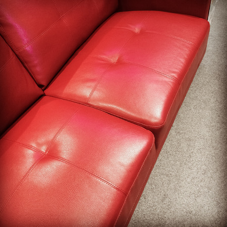 red sofa: Comfortable red leather sofa in retro style