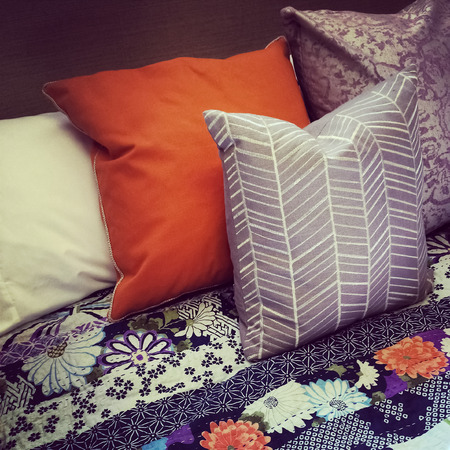 bedlinen: Close-up of a bed with colorful pillows  Stock Photo