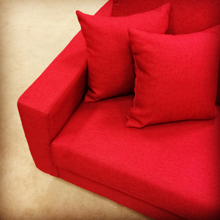 red sofa: Comfortable red sofa with two cushions