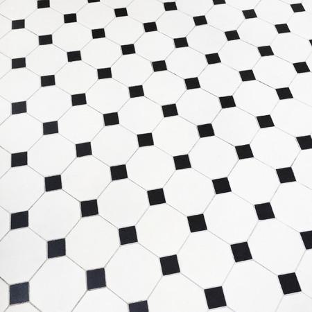 tile flooring: Close-up of black and white ceramic tiles floor. Stock Photo