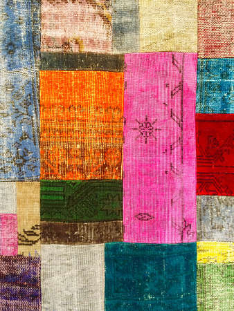 oriental rug: Colorful vintage patchwork rug with ethnic design. Stock Photo
