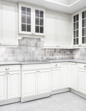 kitchen cabinet: Contemporary kitchen with white cabinets and tiled walls.