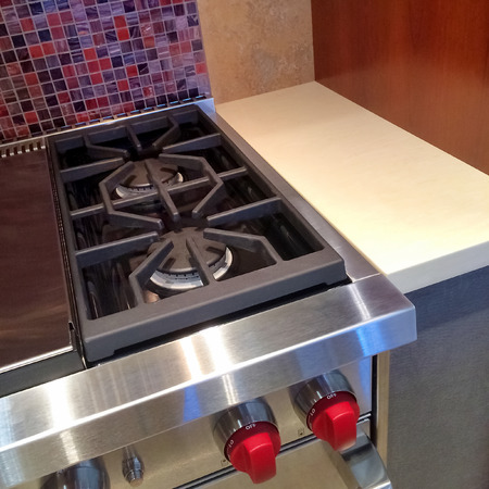 gas stove: Modern kitchen equipped with new gas stove.