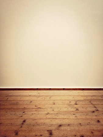 room for text: Interior of an empty room with old wooden floor. Stock Photo