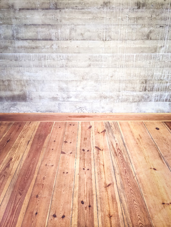 Empty room interior with wooden floor and concrete wall. photo