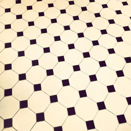 tile flooring: Close-up of black and white retro tile floor. Stock Photo