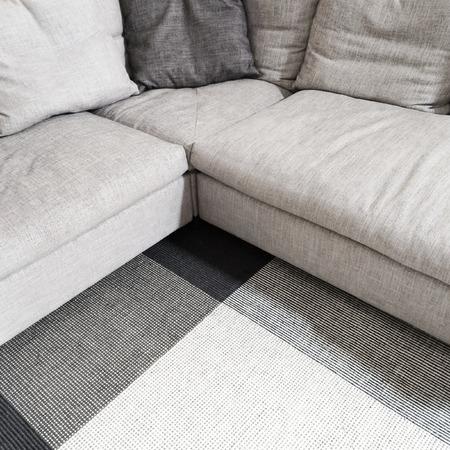 furniture: Gray textile corner sofa and carpet. Modern furniture.