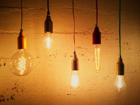 lighting: Light bulbs decorating a concrete wall. Contemporary design.
